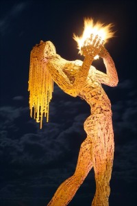 woman-holding-fire-sculpture